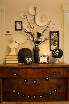 LOVE the black pumpkins and the stencil...Now, this is Halloween decorating that I could get into! DIY Project Parade and a Halloween Vignette
