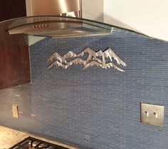 Hello, and thanks for your interest in my Colorado Mountain metal artwork. The dimensions for the listed idem is 6.5 tall by 24 wide. This metal artwork is made by hand with aircraft aluminum that will not rust or tarnish over time. Looks great inside on walls and tile, or outside on the front of the house or fence.  Price 35.00  Bear Mountain Metal Art is based out of Fort Collins Colorado and operated by artist Bobby Singleton. Artwork is made by drawing the design out on a sheet of…