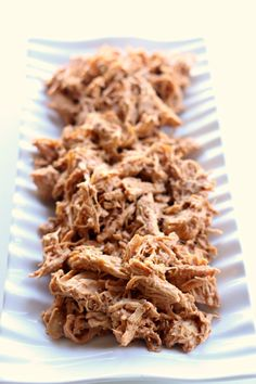 Instant Pot Shredded BBQ Cream Cheese Chicken Recipe--tender chicken breasts cooked in minutes in your pressure cooker and then mixed with cream cheese and BBQ sauce. This chicken is addictive! Perfect to serve on sandwiches, rolled up in tortillas or on pizza.