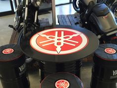 Vinyl wrap table top with tuning fork logo.