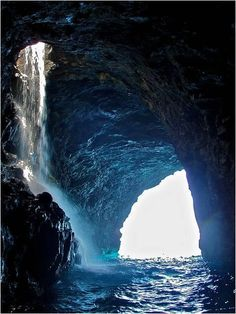 Waterfall Inside a Sea Cave on the Napali Coast! Wa'iahuakua Sea Cave Waterfall, Kauai The Wa'iahuakua Sea Cave on the coast of Kauai, Hawaii is considered one of the most beautiful sea caves in the world. Places Around The World, Oh The Places You'll Go, Places To Travel, Places To Visit, Around The Worlds, Travel Things, Travel Stuff, Dream Vacations, Vacation Spots