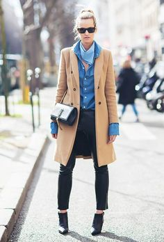 Pair a chambray shirt with a classic camel coat, black skinny jeans, booties, and a neck scarf for some flair.