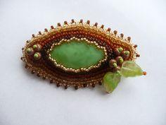 Podzimní+brož+Brož+ve+barváchpodzimu-+hnedá,+zelená,+oranžová+a+zlatá.+Ručne+šitá+z+rokajlových+korálok.+Velikost+7x+4cm.+Podšito+filcom.