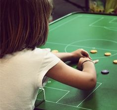 ButtonArtMuseum.com - #Girl playing Button Soccer at Mundial Infantil Futbol Botons Barcelona 2014. #traditional game #buttons #tablegame #ButtonMakerBCN Photography by @HandmadePressHP
