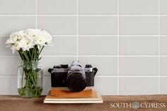 Manhattan Subway tile is the perfect background to display bathroom decor and make it pop!