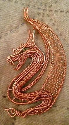 Photo: Made this design for all the dragon freaks like me.. This dragon pendant is wrapped with copper wire. A small Swarovski crystal represents the eye.. can be made with different wire colors. Contact me if interrested..