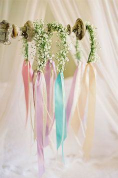A trio of delicate floral headbands will be worn by the bridesmaids throughout…