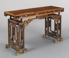 AN ARCHAISTIC HONGMU AND ZITAN RECESSED-LEG TABLE (PINGTOUAN)<br>QING DYNASTY, QIANLONG PERIOD | lot | Sotheby's