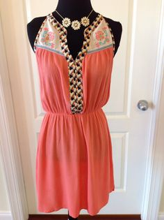 The PARADISE PEACH dress is perfect for vacation. Gauzy, lightweight, elastic waist...need we say more?