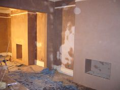 (Plastering and Steel work) double room Plastered with large span for the new R.S.J (Steel) and fitted and boxed in Fireplaces.