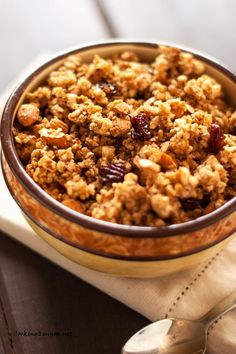 Quinoa Granola 6 servings- 196 cals per serving 5 Rice Cakes, Brown Rice, Plain, Unsalted  ½ cup Quinoa Flakes  ½ cup Fully Cooked Organic Quinoa  ½ cup chopped raw almonds 2 tablespoons maple syrup ½ cup applesauce ½ teaspoon ground cinnamon 1 teaspoon vanilla extract 1 cup dried cranberries