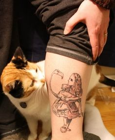 50 Incredible Tattoos Inspired By Books--I love the way the cat is looking at this amazing tattoo