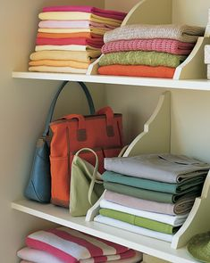 Hang Shelves Upside Down & Use Brackets as Dividers. Looks cool! Or maybe I just really like all the different colored towels... ;)