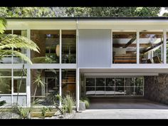 Situated a short stroll from Titirangi Village, this masterclass of Mid-Century design has been meticulously maintained with original detail in. Iron Staircase, Timber House, Beach Shack, Floor To Ceiling Windows, Timber Flooring, Mid Century House, Mid Century Design, Cladding, Home And Family