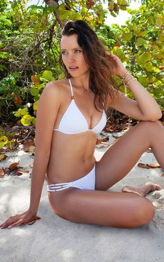 Voda Swim - White Three String Bottom  The bottoms come with a half back scrunch and matching gold accents on three strings for a perfect duo. Jewelry: 14K gold plated chlorine & salt water resistant Fully lined Low coverage Half scrunch back Classic cut Model wears size Small