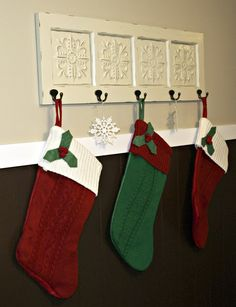 no fireplace? great idea to hang christmas stocking on the wall ...