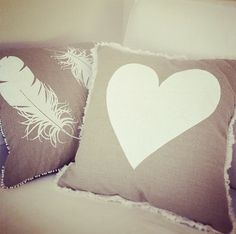 White screen printed love heart with white pom pom trim, and a white feather compliment each other!
