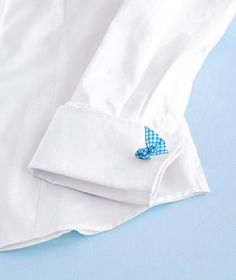 Add a pop of color to a French cuff blouse by using a bright ribbon in place of cuff links.
