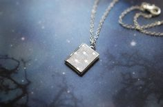 """Silver plated locket necklace with tiny stars - """"Star watcher's book"""". $22.00, via Etsy."""