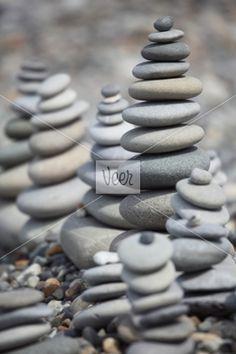 stone stacks on pebble beach Stock Photo