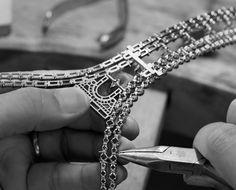 A Louis Vuitton artisan works on the Champs Elysées necklace.