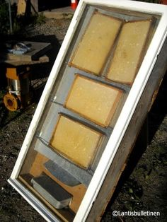 A home built solar beeswax melter, made of wood boards, an old window, styrofoam and galvanized sheet. I have a homemade solar melter - they are awesome.  Carolina Honeybees Farm Blog