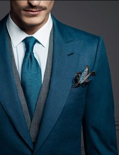 This is almost like a dark teal instead of blue and I like it a lot. Simple color scheme with gray vest. Gray vest is perfect for almost all blue/ teal suits.Follow my blog at EverybodyLovesSuits