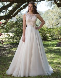 Sweetheart hääpuku 6165. This dress is all about it's girly details of embroidered lace appliques that adorn the bodice, illusion Sabrina neckline, and included satin belt at the natural waist. The full tulle skirt is kept simple and finished with a chapel length train. https://www.sweetheartgowns.com/sweetheart/6165