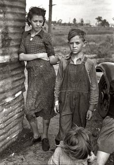 """January 1937. """"Part of the family of a migrant fruit worker from Tennessee, camped near the packinghouse in Winter Haven, Florida."""""""