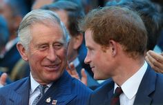 Prince Charles, Prince of Wales and Prince Harry laugh during the Invictus Games Opening Ceremony on September 10, 2014