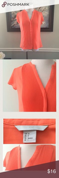 "H&M Neon Orange Silky button down Top Gently worn once. Accordion front. Button down top. Length 23.5"". Chest 19"" across. 100% polyester. H&M Tops Blouses"