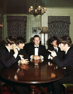 The Beatles with their manager Brian Epstein, 1963. From left to right, Ringo Starr, George Harrison, Epstein, Paul McCartney and John Lennon. Photo by Paul Popper.