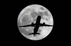 A Virgin America Airlines plane in front of the full moon