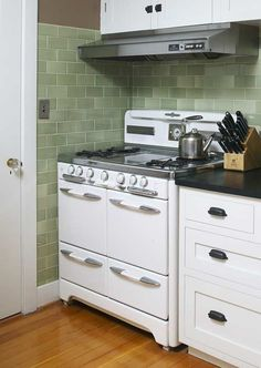 Green subway tiles in an old-fashioned bungalow kitchen.