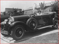 On the road in the '20s: A sassy Clara Bow in her '27 Cadillac Dual Cowl Phaeton. Hat Tip to H.P Olilver (@HP_Oliver) for the image.