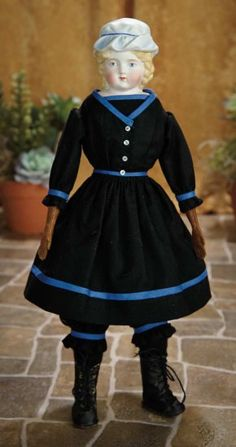 "17""-German Bisque Doll with Sculpted Blue Charlotte Cap, 998, by Alt, Beck and Gottschalk~~~~antique costume. Marks: 998 # 4. Comments: Alt, Beck and Gottschalk, circa 1880. Value Points: especially fine detail of sculpting especially around the eyes, rare sculpted bonnet."