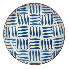 Add a splash of style to your table with our hand-painted serving platter. A school of blue fish swims all over this durable terracotta dish while presenting appetizers, crudites and more to your guests.