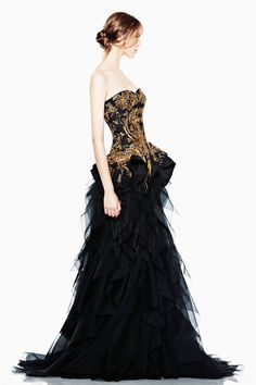 If I got to go to the oscars Alexander McQueen would be the one who would do my dress. I love his work. I mean really look at that dress. Layered Tulle skirt, and a gold threaded bodies.