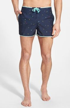 Free shipping and returns on Original Penguin Print Swim Trunks at Nordstrom.com. The penguin joins the colorful tropical party happening on the print of these sharp, vintage-inspired swim trunks framed with sky-blue binding.