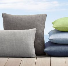 RH's Custom Perennials® Textured Linen Weave Pillow Collection knife edge (I like knife edge better than piped edge.) I like the fog, mink, graphite, and navy/indigo colors. I would also consider putty/brown if cushions on chair were charcoal.