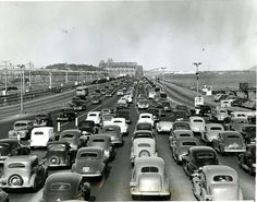 Autos move bumper to bumper in three lanes of traffic from toll gate leading onto San Francisco Oakland Bay Bridge on June 11, 1947, as strike of the key System bus and train operators tied up East Bay and transbay traffic in a wage dispute with the Key System transportation System. Half a million persons were affected.