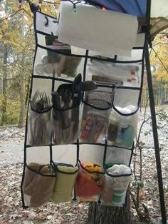 camping tips use a door shoe hanger to put all your stuff in. Never thought is using a shoe door hanging rack for this but its a smart idea!