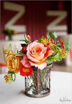 Coral, red, gold and orange for a barn wedding - Photo by Kori
