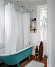 A claw-foot tub and beadboard wainscot replaced an old metal shower stall and plastic faux tile. The fir strips are the only new flooring they installed in the house.