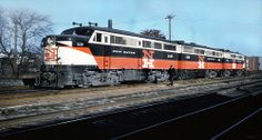New Haven Railroad DER-2 series three unit set of ALCO FA-1's & FB-1 are seen heading a manifest freight train that is stopped to pick up cars at Providence, Rhode Island on January 8, 1958, Mac Seabree Collection