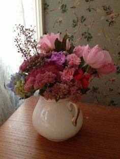 Pink floral arrangement from my garden. I loved the two handled vase this is in ... but alas I recently dropped it and it shattered :(