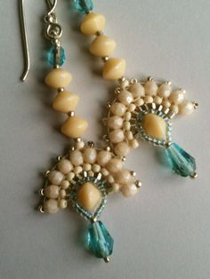 Cream  aqua fan earrings with silver accents by Jeka Lambert.  Seed bead woven.  Glass beads, seed beads.
