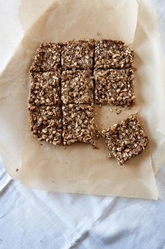 1/2 cup almond butter  1/3 cup maple syrup  1/4 cup butter  1 teaspn cinmon  1/2 teaspn salt   1 1/2 cup old fash oats   2 tabspn grnd flax   1/2 cup chop almonds   In a med saucepan, over low heat combine almond butt, maple syrup, butter, salt and cinn, stirring frequently.  Once fully melted take off heat and add in oats, flax and almonds.Spread mixture in dish lined with parchment paper or foil.  Place in fridge to cool and set.Cut and store in an air tight container.