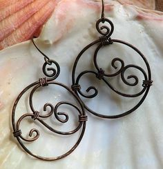 Rustic hammered copper spiral earrings with dark antique patina from Owl Hollow Studio.