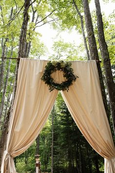 Easy! Hang shower rod and use fabric or curtains for wedding ceremony backdrop.